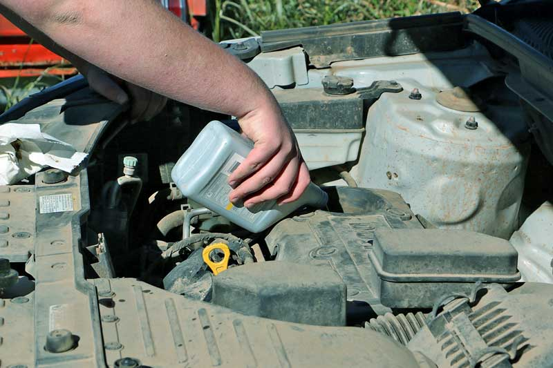Also show them how to add fluids. This will help keep the engine running and ensure more fluid ends up in the car than on the ground.