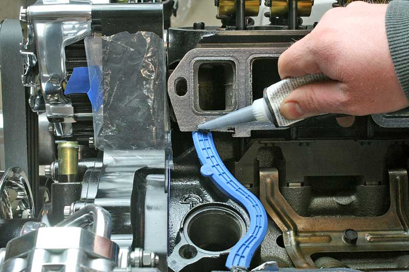 On Ford engines, it is a good idea to add a dab of silicone to the end of the intake gaskets and end seals.