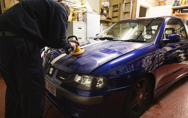 a man power polishing a car