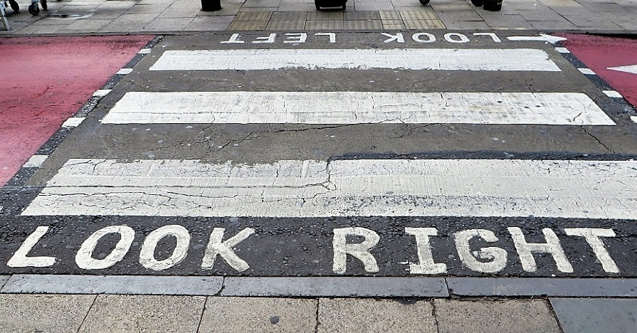 "A crosswalk that says ""Look Right"" and ""Look Left"" on either side."