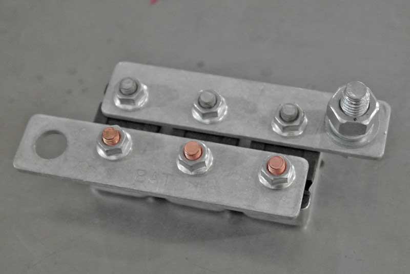 This is a buss bar made of several auto-reset breakers. These are often used in OEM applications where there may be a short high amp draw that is normal, but would trip a standard fuse.