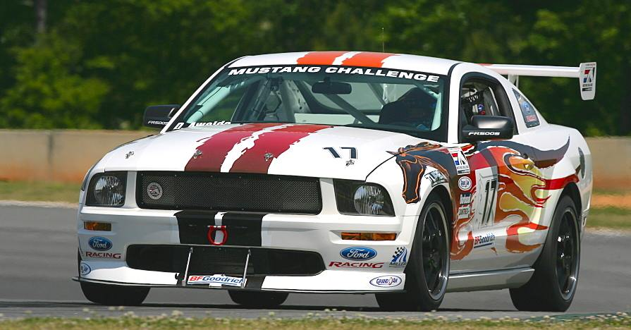 A Mustang car on a racetrack