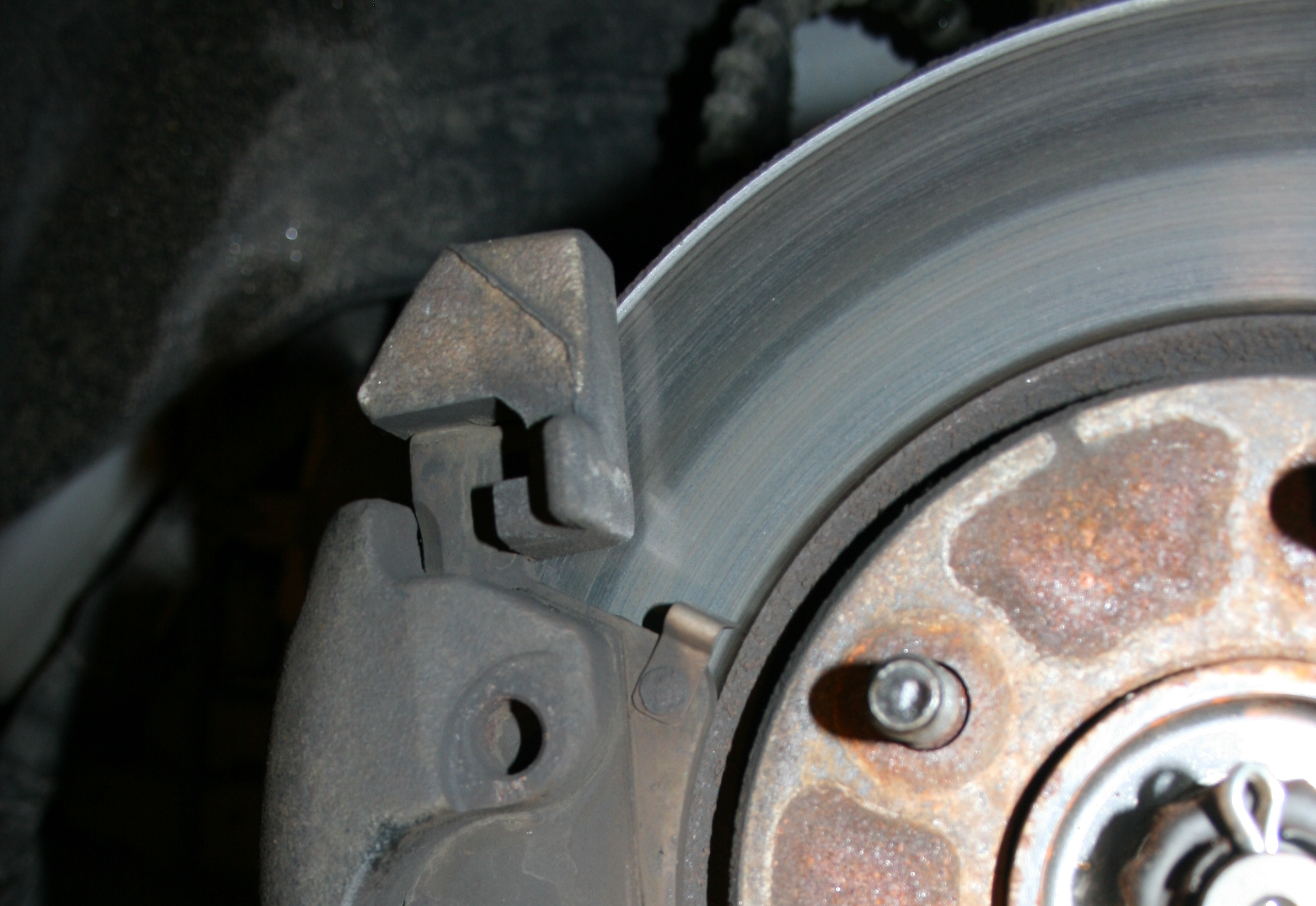Brake Rotor Discoloration: Likely Caused by Sticking Brake Pad.