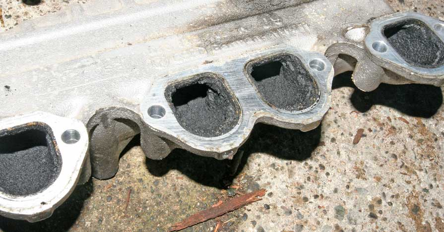 An intake manifold with carbon buildup.