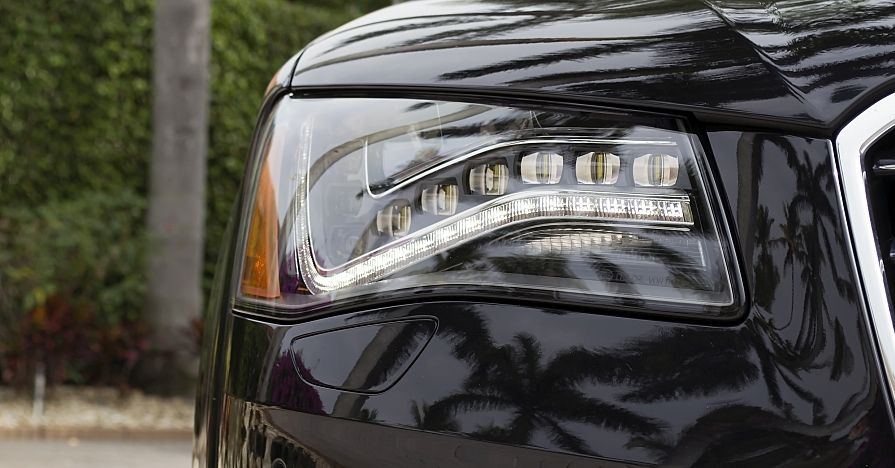 Headlights with auto-dimming high beams on a modern car.