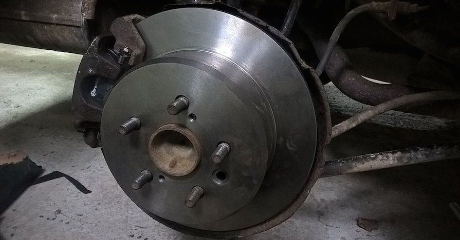 A shiny, new disc brake for a car.