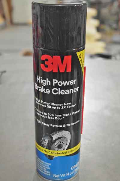 Brake cleaner is one of the best cleaners you can use in the shop. it is safe for painted surfaces and hoses, just don't use it near powder coated items.