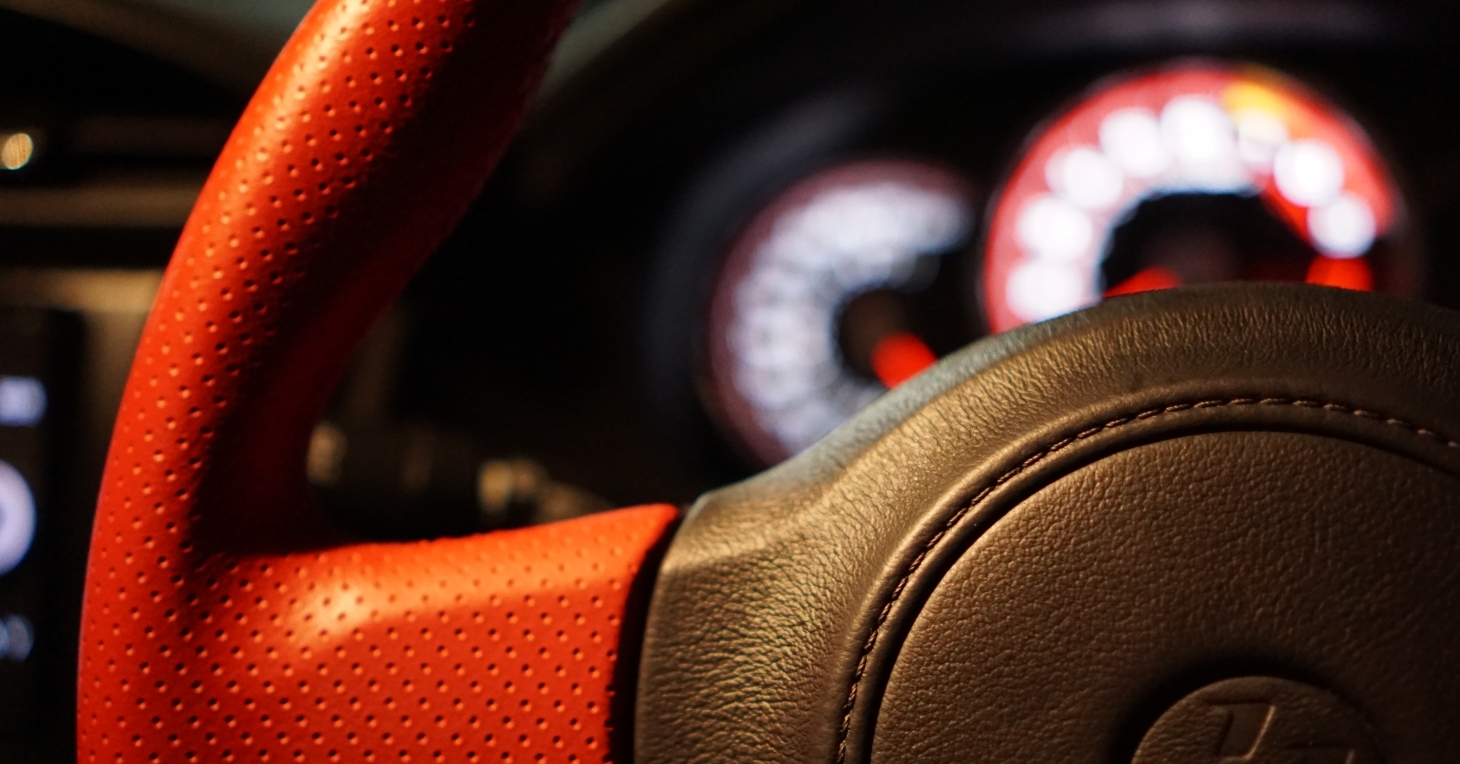 A close-up of a steering wheel.