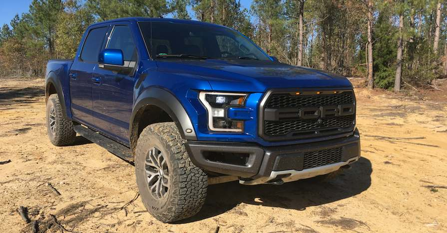 The 2017 Ford F-150 Raptor SuperCrew featured on natural terrain in North Carolina.