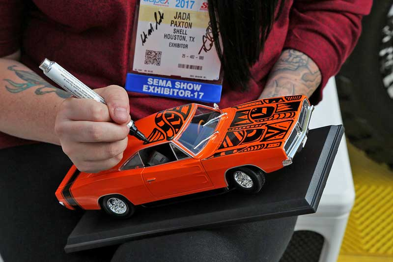 You can also find some unique talents at SEMA as well, like Jada Paxton, an artist brought out by Shell to do custom sharpie art.