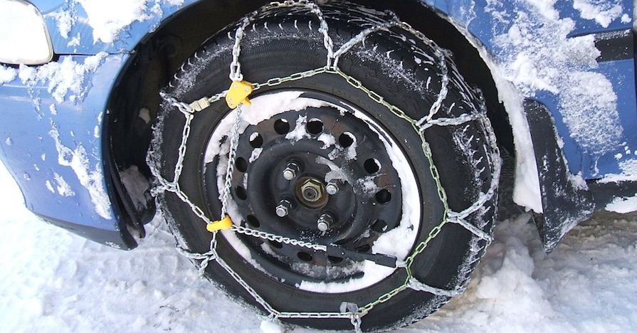 snow chains on a car tire