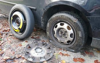 changing a flat with a donut tire