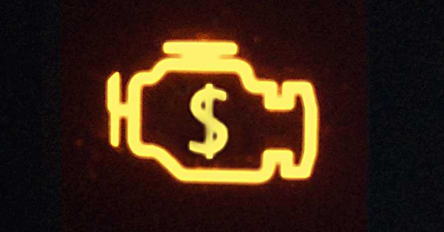 A check engine light is illuminated on a car dashboard.
