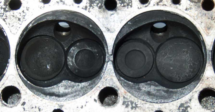 This blackened blown cylinder head gasket has been removed from a vehicle.