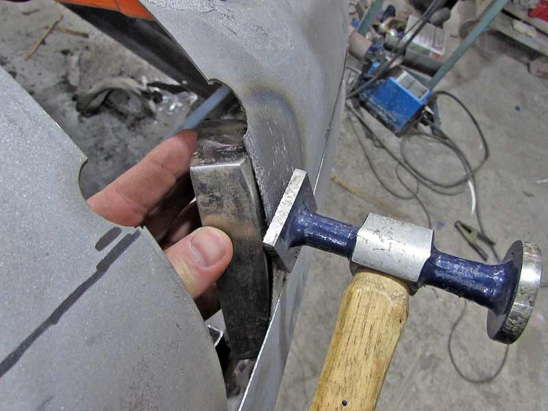 Light taps work best for sheet metal work. You can also work off the dolly, hitting the edge to shape the metal.