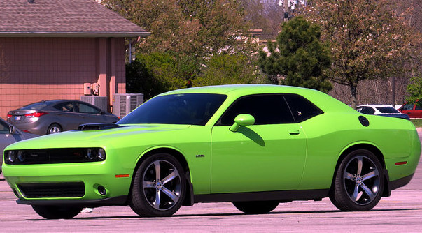 A lime green Dodge Charger with tinted windows