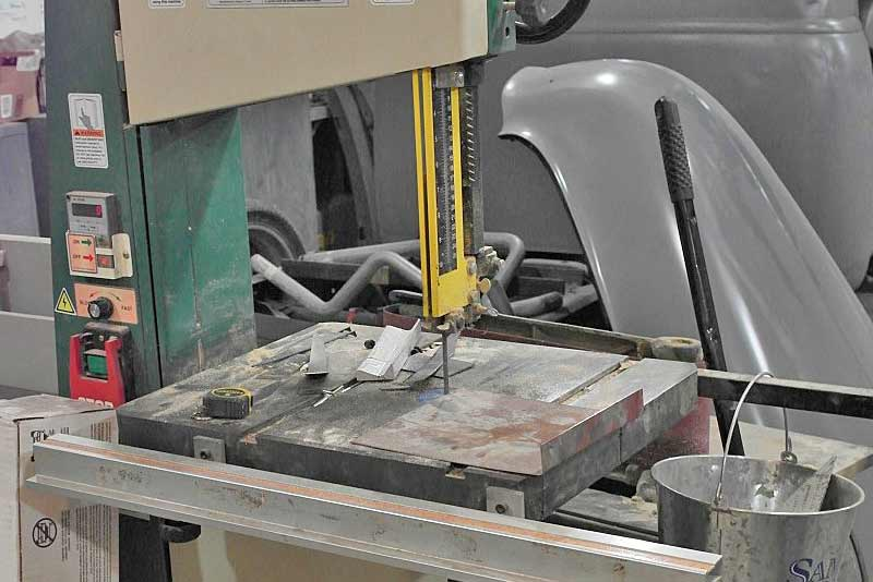 A bandsaw, especially one with adjustable speed like this one can cut just about anything. Remember - slow speed with as many teeth on the blade as you can get for cutting metal.