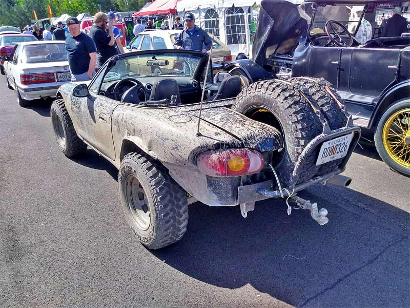 A lifted offroad Miata battle car