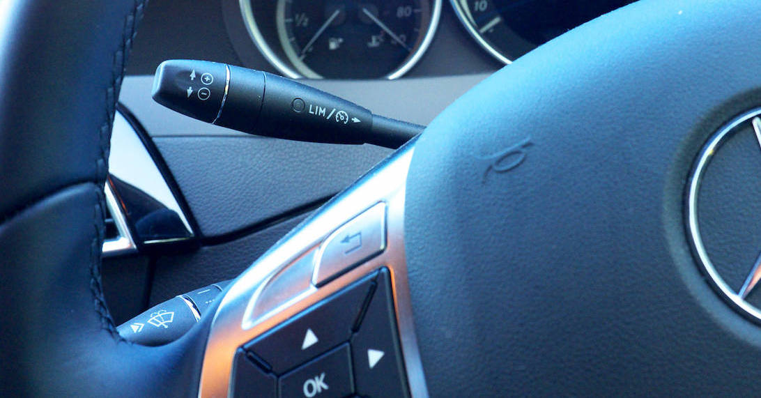 This cruise control stalk on a Mercedes-Benz is a sleek lever behind the steering wheel.