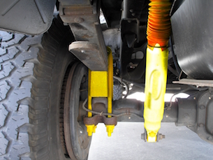LIfting a truck's suspension with axle blocks, U-bolts, and longer shock absorbers, to name a few.