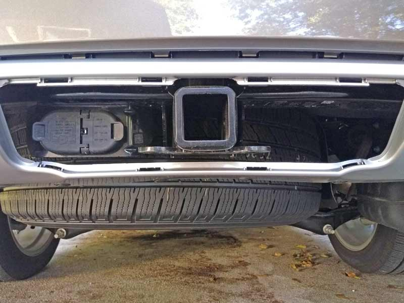 "The built-in Class IV hitch with 2"" receiver is hidden behind a removable panel in the bumper."