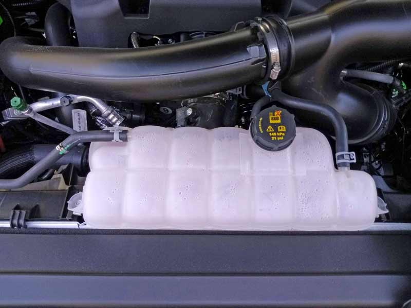 The engine coolant reservoir is located front and center for easy checking and filling.