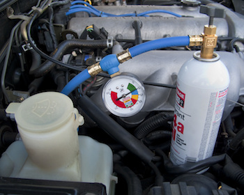 An auto air conditioning system top-off kit with a good gauge can help you get the right pressure in the system.