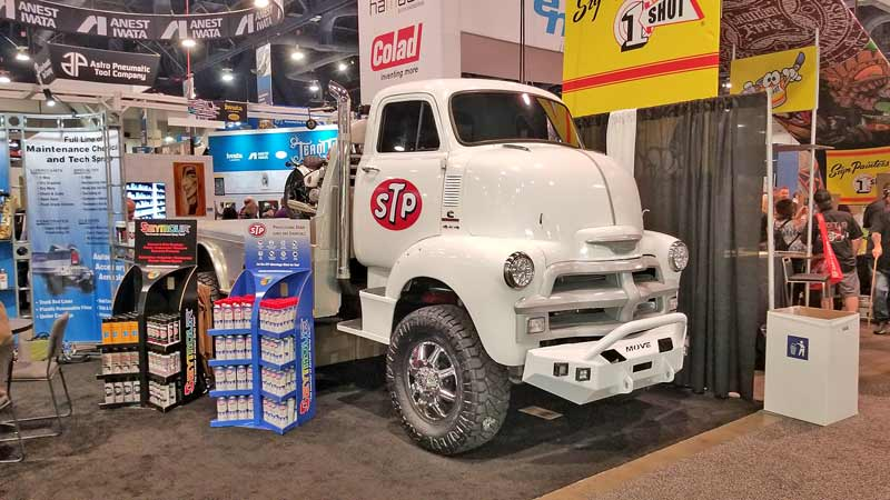 STP has a great display with a couple of really cool COE trucks. Not sure about the modern bumper, but we love the rest.