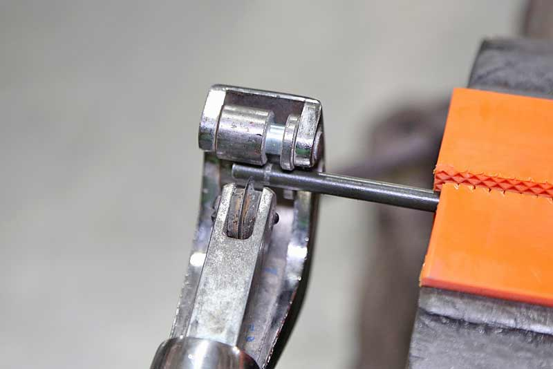 The cutter is placed on the tubing and the tool was tightened onto the tubing. Then the tool is spun on the tube.
