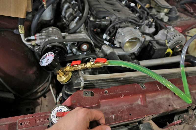 Then we opened the valve. The vacuum will pull coolant into the system, ensuring it is full and no air is present.