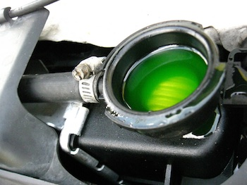 Green antifreeze sits in a car's radiator to prevent an engine running hot