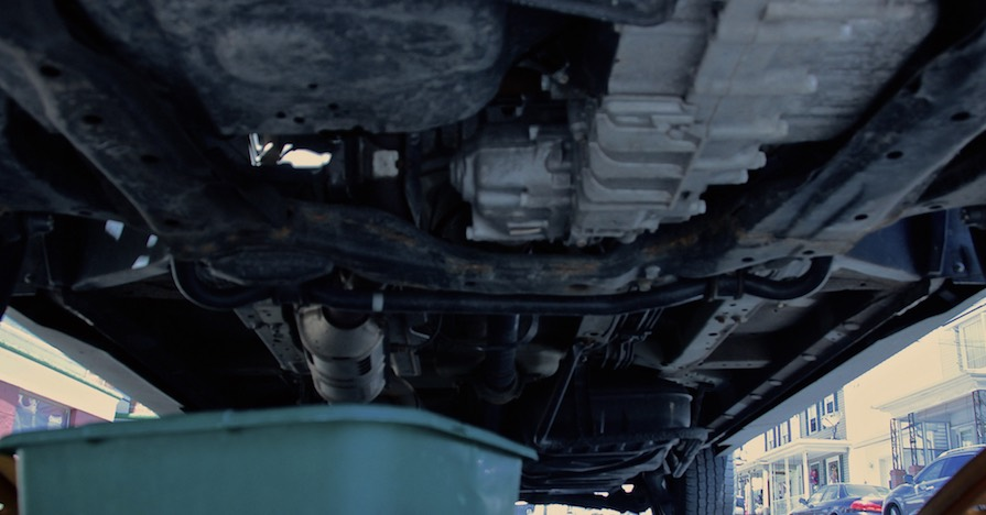A pan waits to receive engine oil during a change.