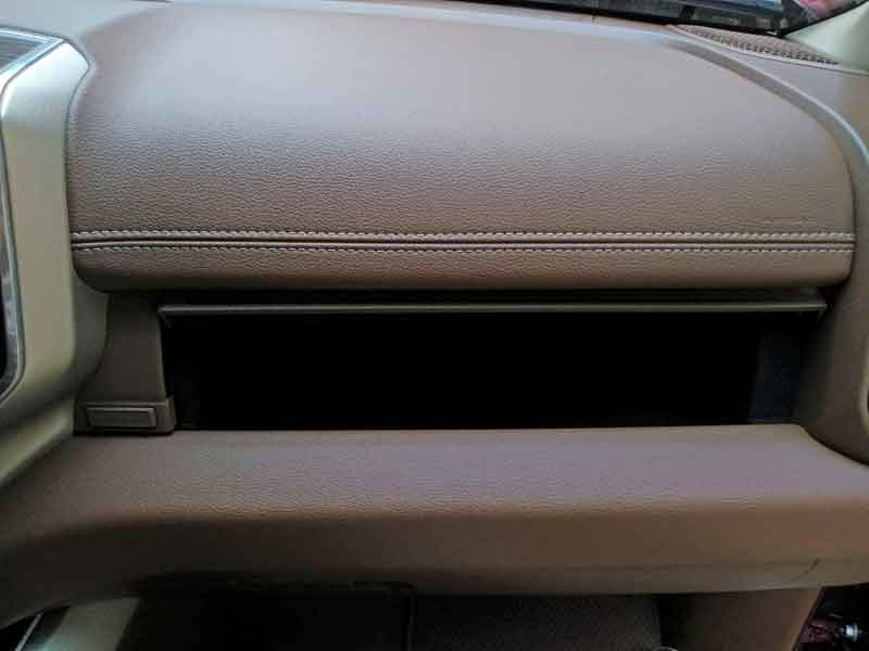 There is a second, shallower glove box located above the normal hinged glove box.