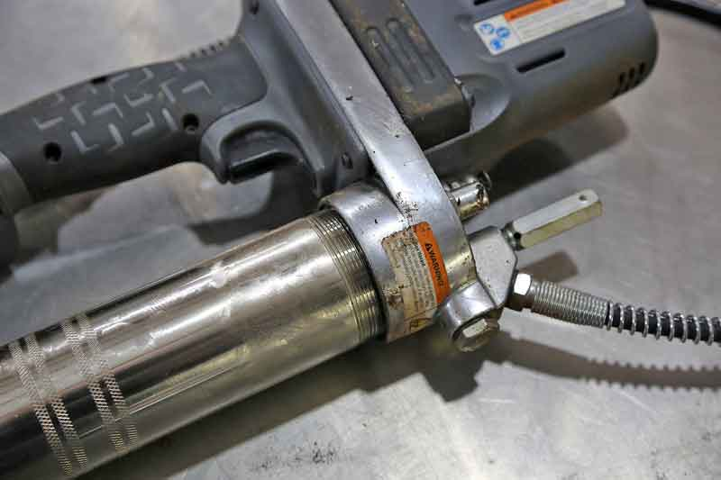 Next, unscrew the main barrel which holds the grease.