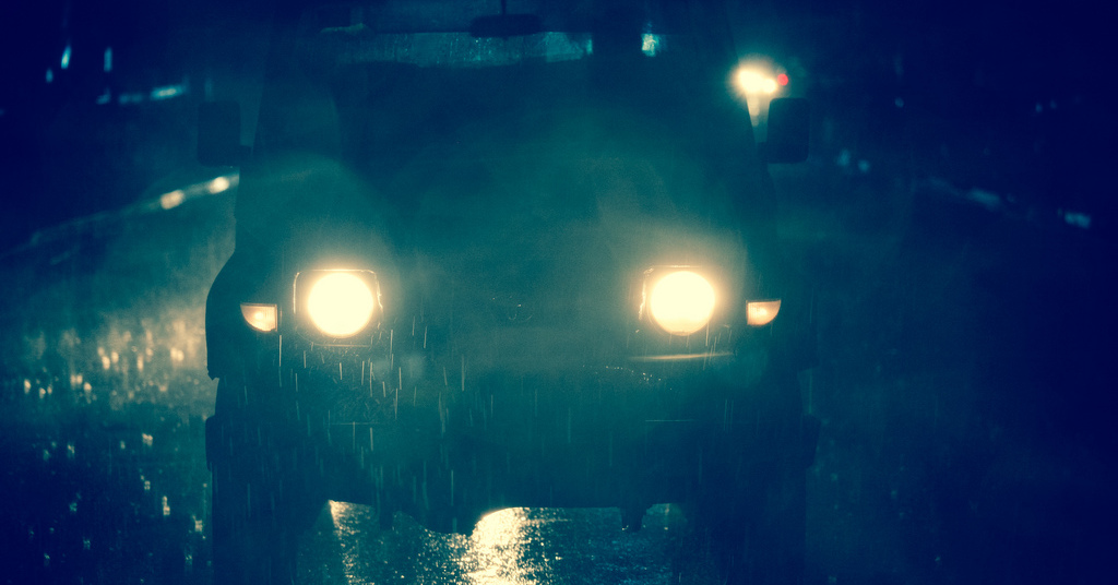 An SUV's headlights at night. Some headlights lose their ability to light the road ahead as they age. Here's how to deal with fading headlights.