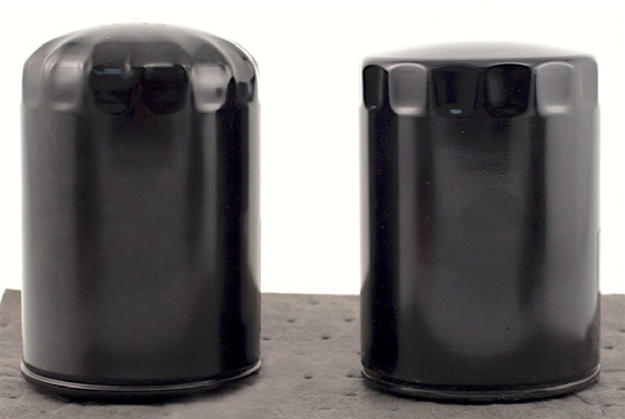 A bloated oil filter (left) next to a normal oil filter (right).