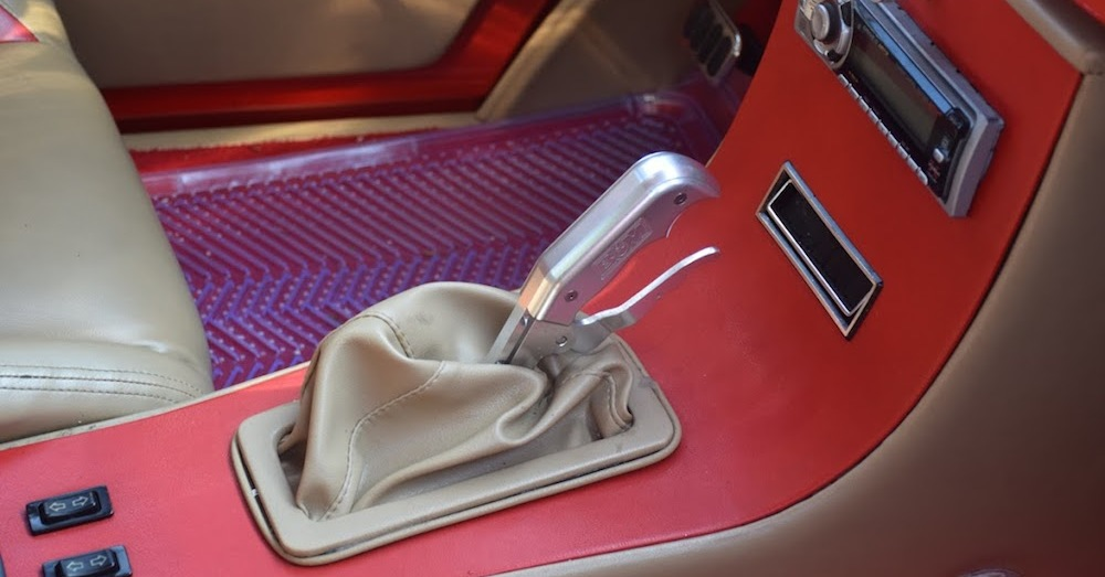 A hand-operated parking brake in a classic car. Engaging your car's parking brake when you're done driving is a precautionary step that can hold your vehicle in place.