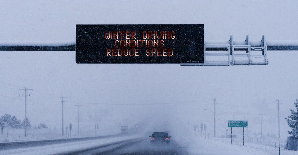 A warning sign on a digital board during a snowstorm. Winter doesn't just make it difficult to get around, but colder temperatures can have a drastic effect on your car.