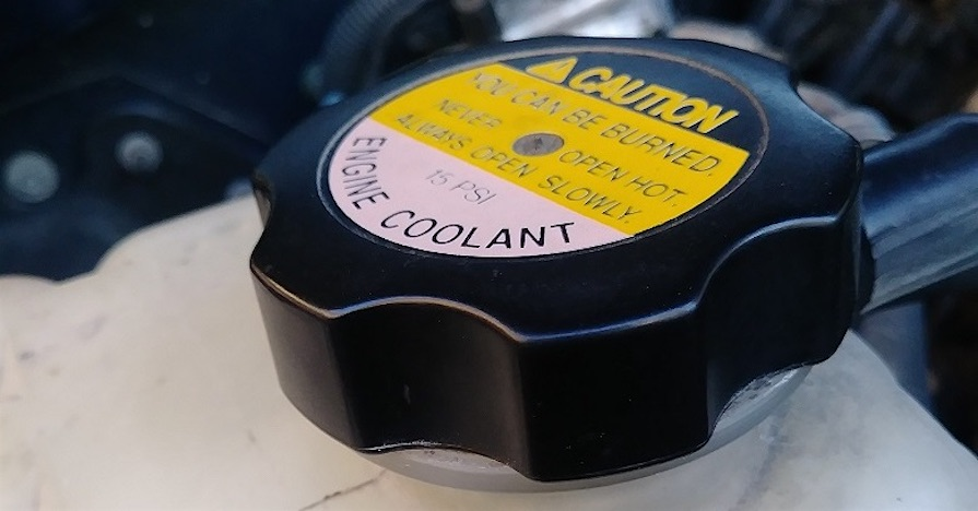 A coolant cap on a car. There are three major types of coolant, which include HOAT, OAT and IAT. Here's how to tell the difference between the three and four things to know about HOAT.