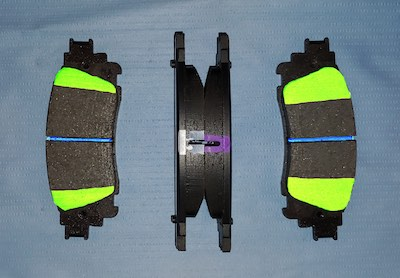 The chamfer and thickness varies between the inboard and outboard brake pads.