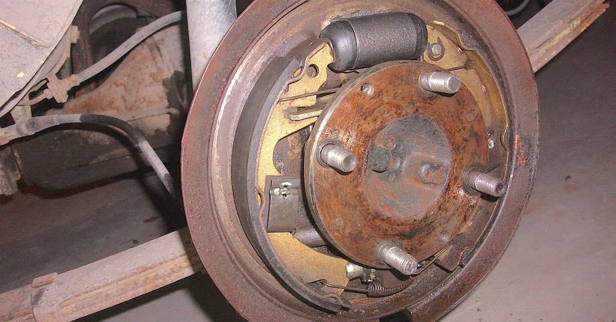 A car's rear drum brake. Ever wondered why drum brakes are still around? Disc brakes may offer more stopping power, but drum brakes have some advantages, too.