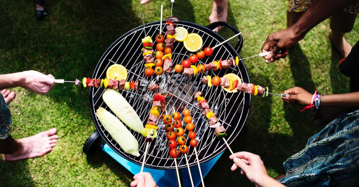 Friends barbecuing at a tailgate party. Some cars are made to tailgate, while others aren't. If you love tailgating, here are some things you'll need.