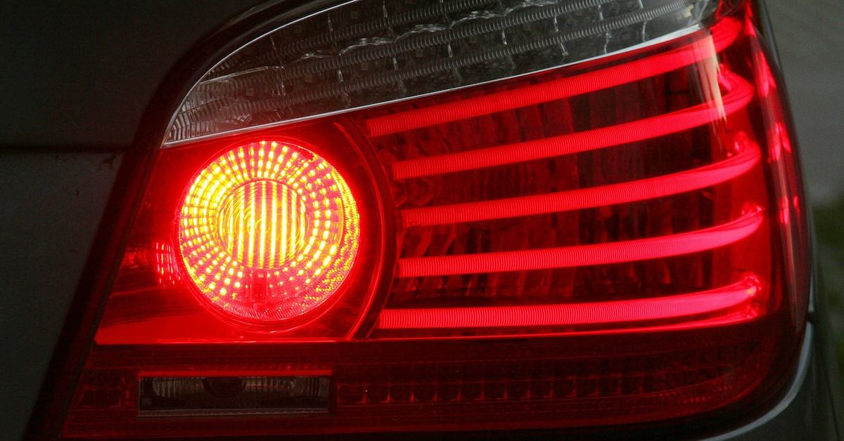 A car's brake light. Ever wondered what ABS is? Here's everything you need to know about anti-lock brakes.