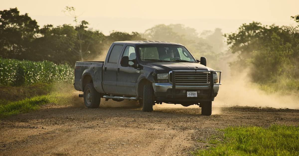 Pickup truck on dirt. Choosing the right motor oil for your pickup truck can be a difficult task. From extreme heat, towing, and long highway miles, your truck's engine needs good oil.