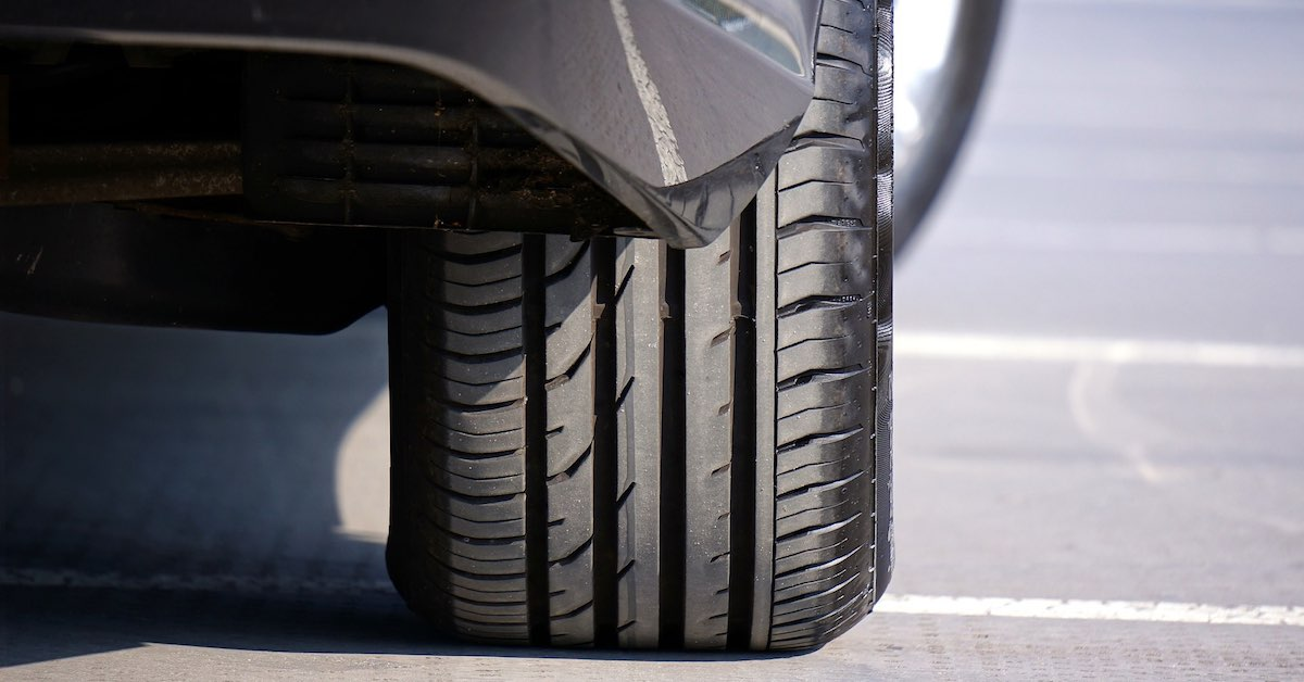A rear tire on a car. When your car's ride starts to get bouncy, it might be time to change a few suspension components. Here are 11 tips to tackle a strut replacement on your car.