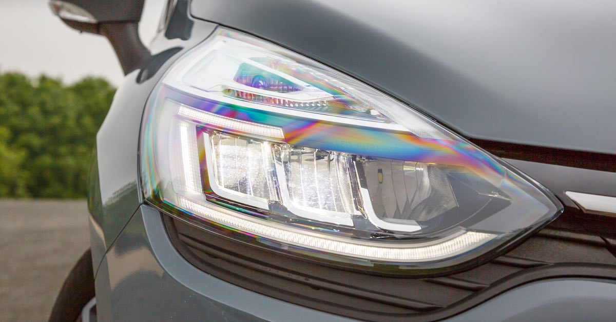 Headlights on a gray car. Working headlights are essential for every vehicle on the road.