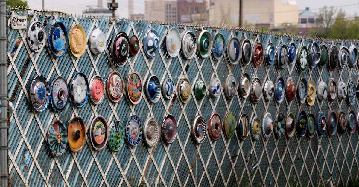 Hubcap art. Old hubcaps can make any fence interesting.
