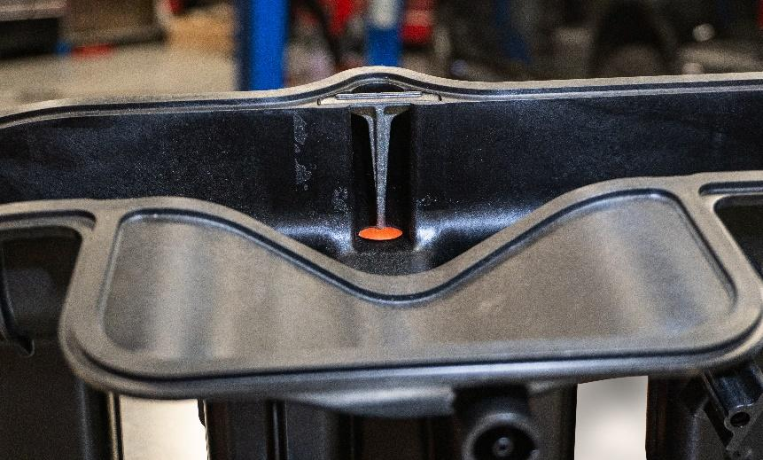 Retainer insert ensures the PCV valve (orange) stays in place in the manifold. This solves the 1.4L Ecotec oil burning.
