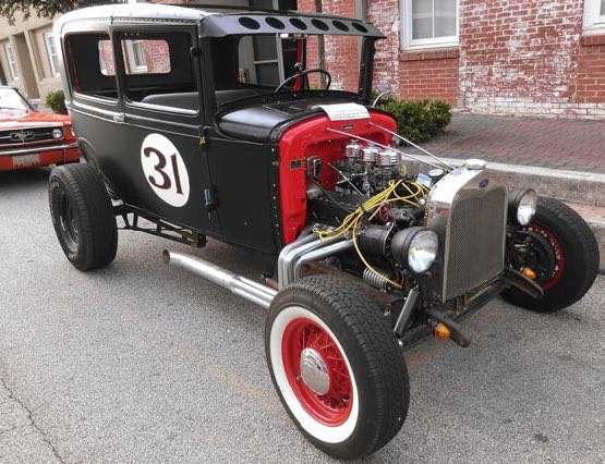 a finished hot rod in black and red