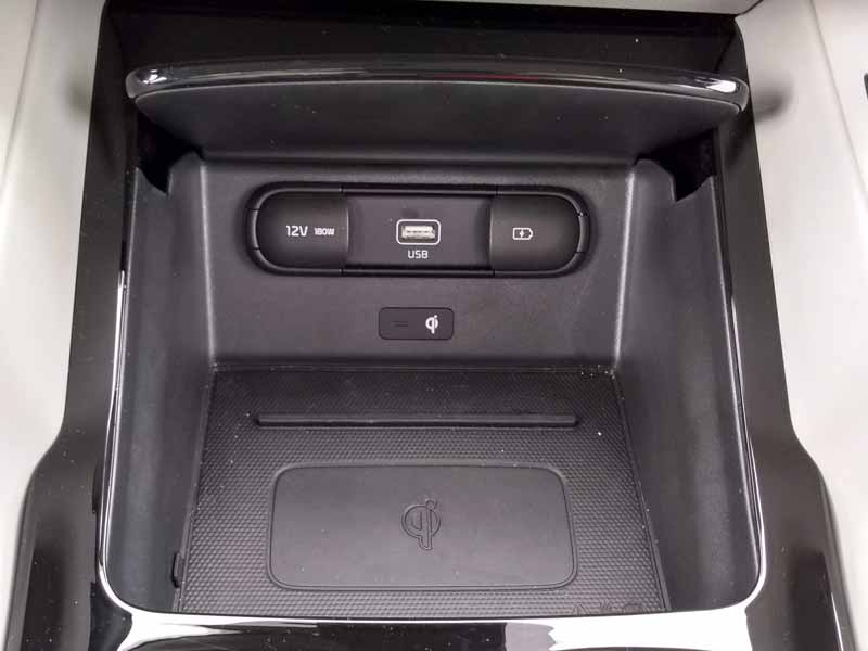 Kia Telluride center console storage cubby with wireless charger and USB port